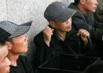 Девять китайцев помещены под стражу за расовую дискриминацию