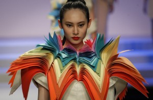 A model presents a creation at the BIFT Graduates Show 2012 held during China Fashion Week in Beijing, China, Thursday, March 29, 2012. (AP Photo/ Vincent Thian)