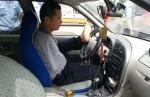 Безрукий водитель задержан в Китае
