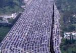 В преддверии праздника Середины Осени жители покидают Пекин